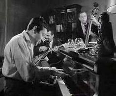 Beautiful, smoke-fueled performance with Serge Gainsbourg and jazz ensemble, 2:14, 1964