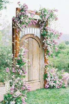 Gorgeous garden door covered in roses.