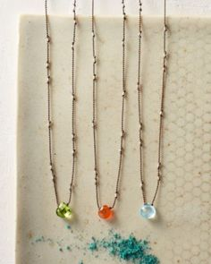 This looks like a new take on a simpler style necklace I make!  Garnet Hill: Margaret Solow Petite Stone Necklace
