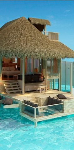 Six Senses Resort Laamu, Maldives...you stay ON the water there is even a hammock built in to soak in the ocean!
