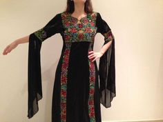 Palestinian embroidery with medieval style dress