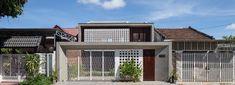 wood slats, patterned bricks + skylights compose X11 design studio's time house in vietnam