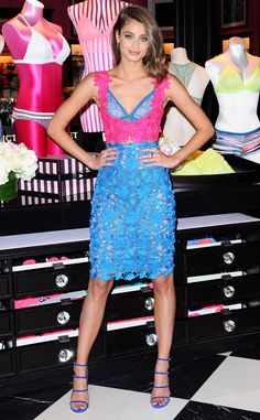 Flower Bombshell from Fashion Police  Victoria's Secret model Taylor Hill works it in a floral Monique Lhuillier ensemble and blue Stuart Weitzman heels at a launch event in Santa Monica.