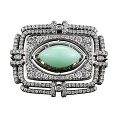 Marquise Shaped Cabochon Green Opal Diamond Gold Platinum Cocktail Ring | From a unique collection of vintage cocktail rings at https://www.1stdibs.com/jewelry/rings/cocktail-rings/