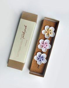 Crochet Plumeria hair pins and pattern.