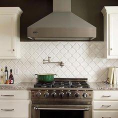 Quatrefoil-pattern tiles add subtle dimension and texture to this pretty kitchen: http://www.bhg.com/kitchen/backsplash/behind-the-range-tile-backsplash/?socsrc=bhgpin040714patternedtilebacksplash&page=4