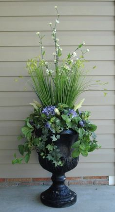 urn with variety of flowers and greenery, love the height