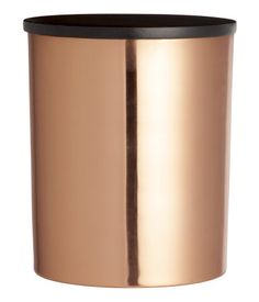 Metal canister with a wooden lid. Diameter 4 in., height 4 3/4 in.