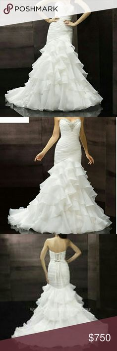 Wedding Dress/Gown 2015/2016 (excellent condition) Strapless organza trumpet gown with ruffles cascade along the skirt and Swarovski crystals and silver embroidery on the ruched bodice and sweetheart neckline. A half corset closure finishes the look. Excellent condition, worn once, white, size 16, fit size 12-14. Straps in the back for perfect adjustment. moonlight  Dresses Wedding