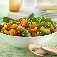 Fresh spinach, avocado, and chopped orange topped with zesty tomatoes.