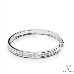 Bangle bracelets are a stylish jewelry accessory. The classic design of this striking channel set diamond bangle bracelet is versatile and attractive. Worn alone, or stacked with other bracelets, this bracelet will add brilliance to your look. The piece locks effortlessly into place with a hinged clasp that includes a safety lock. Customize in the carat weight of your choice and then select 14k, 18k, or Platinum.  Channel Set Diamond Bangle Bracelet | Amouria