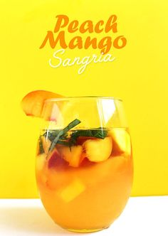 Peach Mango Sangria. Super Refreshing. Easy to make. Bursting with fruity flavor! Perfect for a hot summer evening. #sangria #summercocktail #refinedsugarfree | robustrecipes.com