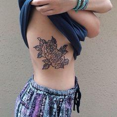 Black outline of flowers/roses/peonies side rib tattoo