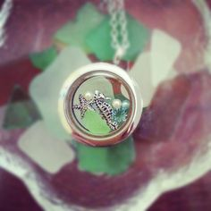 South Hill Designs locket with beach glass from Hawaii. http://www.southhilldesigns.com/janicepalumbos/default