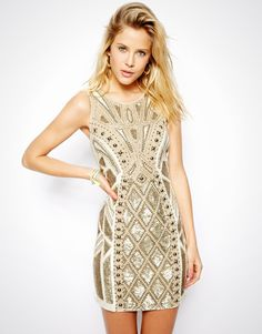 Shine bright in this geo mini dress. #goldrush