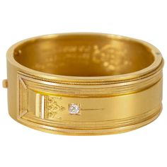 Exquisite Victorian Gold Bangle Bracelet with Engraved and Relief Design. This stunning cuff bangle bracket is 18k yellow gold set with a diamond of approximately 10pts. It has exquisite Victorian relief Eastlake style detailing. This is a finely made piece that has been engraved on the inside for a Birthday present dated November 1882. This is in excellent condition.Interior circumference is approximately 6 7/8.