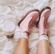 Pastel pink doc martins complimented with a Starbucks
