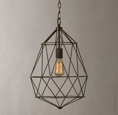 RH TEEN's Elysian Pendant:A new angle on the classic cage pendant. Fine, twisted steel takes the shape of a faceted gem, showcasing the unobstructed light of a single bulb.