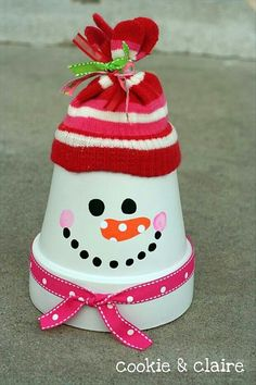 Painted terra cotta pot with dollar store glove for a hat & ribbon.