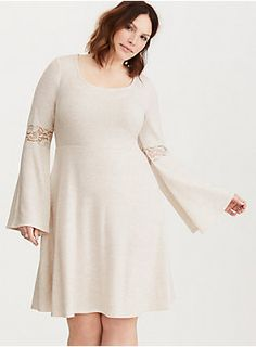 """<div>This oatmeal hacci knit skater dress is our softest yet, with a slightly brushed feel. The fitted bodice flares out with a stretchy waistband, with bell sleeves that turn up the volume. Lace insets trim the sleeves, lending romantic appeal.</div><div><br></div><div><b>Model is 5'9.5"""", size 1</b></div><div><ul><li style=""""list-style-position: inside !important; list-style-type: disc !important"""">Size 1 measures 41"""" from shoulder</li><li style=""""list-style-position: inside ..."""