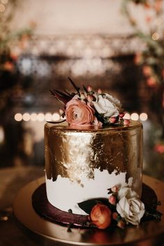 The metallic foiled look on this cake is totally spot on with fall trends | Image by Katrina Nicole Photography  #cake #weddingcake #cakedesign #weddingcakedesign #weddingcakeinspiration #cakeinspiration #cakedecoration #cakeideas #bilbobaggins #hobbit #thehobbit #quirkywedding #wedding #elegantwedding #fallwedding #weddinginspiration