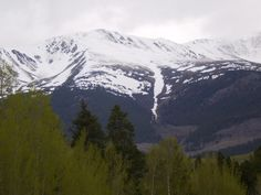 Snow-Capped Mountain - beautiful with clouds hovering above.