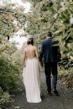 Bride wears an Elegant Backless Wedding Dress. PhotographyGeorgina Harrison #backlessweddingdress #weddingdress #weddinggown #bridalgown #bridaldesigner #weddingfashion #weddingstyle