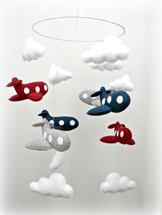 Airplane mobile - baby mobile - nursery decor - You pick your colors - crimson, navy, gray felt airplanes, white clouds - custom made. $257.00, via Etsy.