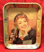 """They don't serve Coke on trays anymore. But back in the Coke in glasses was served at soda parlors on colorful metal trays such as this original """"Menu Girl"""" tray. Even the ad slogans are on the rim of this tray: Thirst knows No Season and Have a Coke. Coca Cola Drink, Cola Drinks, Pepsi, Vintage Coca Cola, Vintage Advertisements, Vintage Ads, Vintage Items, Vintage Posters, Vintage Metal"""
