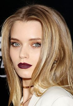 Australian actress and model Abbey Lee Kershaw wears a dark lip with light, shimmery eyes