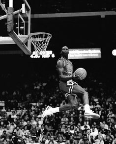 Michael Jordan of the Chicago Bulls attempts a dunk during the 1988 Slam Dunk Contest on February 6 1988 at Chicago Stadium in Chicago Illinois. Art Michael Jordan, Michael Jordan Pictures, Michael Jordan Basketball, Jordan Photos, Basketball Legends, Nba Basketball, Ar Jordan, Nba Pictures, Kobe Bryant Nba