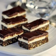 ROCK RECIPES - These delectable, no-bake Chocolate Mint Nanaimo Bars are a twist on a classic Canadian treat that originated in its namesake town in British Columbia. Nanaimo Bars, Köstliche Desserts, Delicious Desserts, Dessert Recipes, Baking Recipes, Cookie Recipes, Easy Recipes, Romanian Desserts, Rock Recipes