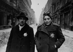 Budapest after the liberation by the Red Army: Jewish couple on a street in the Jewish ghetto wearing the Star of David on their coats - January 1945 Picture by Jevgeni Chaldej Get premium, high resolution news photos at Getty Images Nazi Propaganda, Soviet Army, Soviet Union, World History, World War Ii, Jewish History, Jewish Art, Jewish Ghetto, Lest We Forget