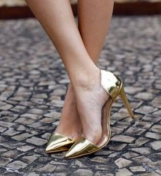 Gold tipped and heeled pumps.