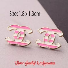 Luxury design white and Pink C Logo Stud earrings New luxury design White and pink stripe C logo Stud Earrings. Size 1.8cm x 1.3cm Love's Jewelry & Accessories Jewelry Earrings