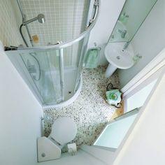 современная угловая сантехника в ванной
