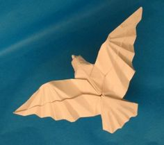 One of a kind origami flying bird - http://www.ikuzoorigami.com/one-of-a-kind-origami-flying-bird/
