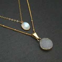 Rainbow moonstone and gray druzy come together in a gorgeous gold layered necklace set.   Both of these pieces are on a gold filled chain which will retain its pretty gold color for years. The druzy is on a satellite-style chain with delicate little balls for some extra dainty texture.