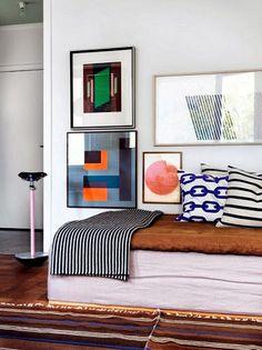 stripes on banquette, framed prints above...