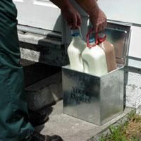 The Milkman leaving your order in your milk box  right outside your door!  Our milk was delivered by Sousa's!