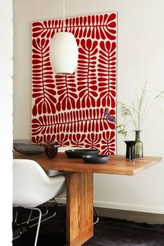"""RELATIONSHIP CORNER..One of the designer's favorite pieces of art is by Mitjili Napurrula, a stunning red and white canvas with """"amazing depth and rich red hues,"""" Ellis says. She and her husband bought it on their first wedding anniversary."""