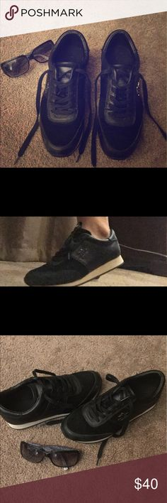 Authentic Coach black Shoes Super cute! Hardly worn. Great Condition. Props are not part of the sale. Coach Shoes Sneakers