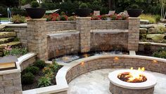 firepit, backyard patio, water application, lighting, retaining wall, concrete block wall, Allan Block, night lighting in landscaping, pond and waterfall with c