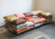 Sew a bunch of pillowcases together, then insert the pillows! Would make a great squishy movie couch. or chair.