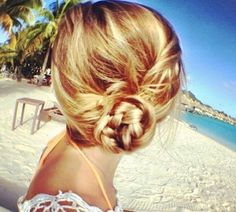 {low braided side bun ~ pull hair into a low pony, braid the pony and then twist and pin in place}