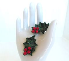 Hey, I found this really awesome Etsy listing at https://www.etsy.com/listing/161207584/vintage-clip-earrings-enameled-holly