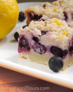 Blueberry Lemon Pie Bars: creamy pie filling studded with juicy blueberries, sandwiched between buttery shortbread crusts, and topped off with lemon zest.
