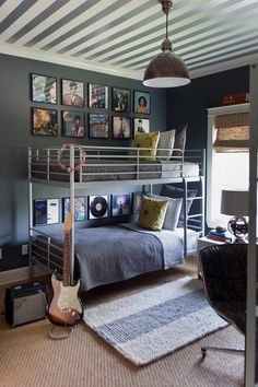 Things get even groovier in her boy's room with framed album covers, a striped ceiling and an electric guitar.