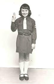 This looks like the Brownie uniform I wore. My pixie badge had to be polished and shiny and my tie perfectly ironed and tied. I liked the knitted hat which was easy to wear. I learned how to lay a table and darn socks at Brownies. Brownies Girl Guides, Brownie Guides, 1970s Childhood, My Childhood Memories, Uk History, Family History, Scout Uniform, Vintage School, Thinking Day