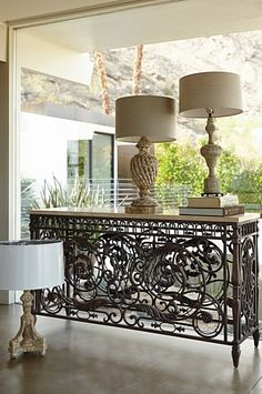 Intricate wrought iron wraps around all sides, echoing the balconies of historic piazzas. Smooth travertine completes the timeless appeal of our Balcony Console Table.